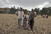 Etinesh, 11 years old, second from right and Torokan, 8 years old, second from left, walk with their new husbands to their new villages after celebrations for their marriages took place  in their native village in Northern Amhara region on February 14, 2009 in Ethiopia..While in decline, early child marriage is still widely spread in rural areas of Ethiopia where families sell their daughters into marriage at ages as young as 5 years old...Names of subjects have been fictionalized and specific locations have been omitted to protect the identities of the children portrayed in the story.