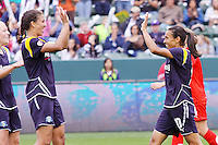 Marta #10 and Shannon Boxx #7 of the Los Angeles Sol celebrate thier 2-0 victory over the Washington Freedom in their inaugural match at Home Depot Center on March 29, 2009 in Carson, California.
