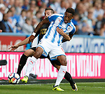 Rajiv van La Parra of Huddersfield Town tussles with Javi Manquillo of Newcastle United during the premier league match at the John Smith's Stadium, Huddersfield. Picture date 20th August 2017. Picture credit should read: Simon Bellis/Sportimage
