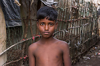 Bangladesh, Cox's Bazar. Kutupalong Rohingya Refugee Camp. The Rohingya, a Muslim ethnic group  denied citizenship in Burma/Myanmar have escaped persecution from Burmese militants in their country. There are up to 500,000 refugees and migrants living in makeshift camps in Cox's Bazar. Boy in the camp.