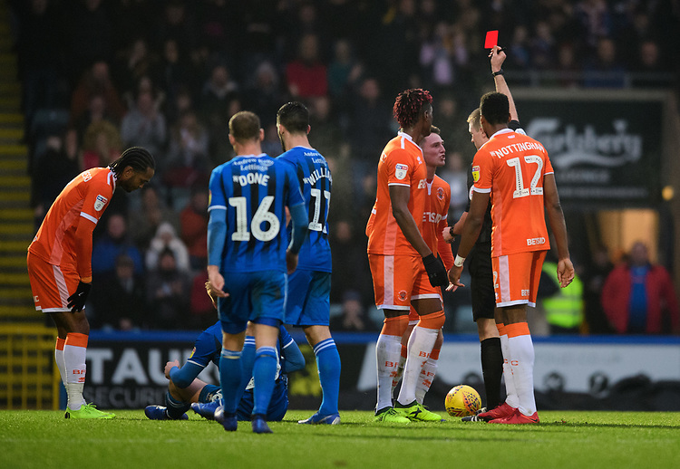 Blackpool's Jordan Thompson is shown a red card by referee Thomas Bramall<br /> <br /> Photographer Chris Vaughan/CameraSport<br /> <br /> The EFL Sky Bet League One - Rochdale v Blackpool - Wednesday 26th December 2018 - Spotland Stadium - Rochdale<br /> <br /> World Copyright © 2018 CameraSport. All rights reserved. 43 Linden Ave. Countesthorpe. Leicester. England. LE8 5PG - Tel: +44 (0) 116 277 4147 - admin@camerasport.com - www.camerasport.com