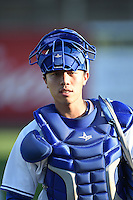 Dunedin Blue Jays  catcher Derrick Chung (1) walks to the dugout before a game against the Brevard County Manatees on April 11, 2014 at Florida Auto Exchange Stadium in Dunedin, Florida.  Brevard County defeated Dunedin 5-2.  (Mike Janes/Four Seam Images)