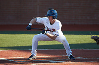 Mitch Farris (15) of the Wingate Bulldogs squares to bunt against the Concord Mountain Lions at Ron Christopher Stadium on February 2, 2020 in Wingate, North Carolina. The Mountain Lions defeated the Bulldogs 12-11. (Brian Westerholt/Four Seam Images)