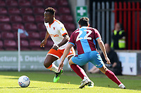 Blackpool's Marc Bola sturggles to find a way past Scunthorpe United's Levi Sutton<br /> <br /> Photographer David Shipman/CameraSport<br /> <br /> The EFL Sky Bet League One - Scunthorpe United v Blackpool - Friday 19th April 2019 - Glanford Park - Scunthorpe<br /> <br /> World Copyright © 2019 CameraSport. All rights reserved. 43 Linden Ave. Countesthorpe. Leicester. England. LE8 5PG - Tel: +44 (0) 116 277 4147 - admin@camerasport.com - www.camerasport.com