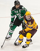 Dillon Simpson (North Dakota - 18), Sam Warning (MN - 11) - The University of Minnesota Golden Gophers defeated the University of North Dakota 2-1 on Thursday, April 10, 2014, at the Wells Fargo Center in Philadelphia to advance to the Frozen Four final.