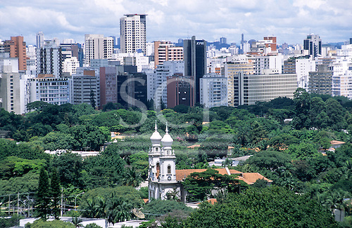 Sao Paulo, Brazil. Overview of the leafy and fashionable Jardins district and the Nossa Senhora do Brasil church; high-rise buildings behind.