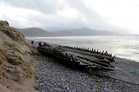 GLENBEIGH IRELAND JANUARY 7TH 2014:  The wreck of The Sunbeam at Rossbeigh Strand in Co. Kerry  which has been embedded in the sand for 111 years but last night's storm propelled the wreck from its sandy grave and dumped it on the rocks about half a kilometre away.  Hundreds of people are flocking to see the wreck and also the wrecked shorline.<br /> Photo shows the wreck in its new position on Monday.<br /> Picture by Don MacMonagle HISTORY: Schooner Sunbeam. A Wooden Schooner Built in 1860 by Walters in Exmouth. She was owned by her Builder up to the late 1870s and was then bought by Richard Kearon of Arklow. On January 1st 1903 when on a Voyage from Kinvara to Cork she was driven ashore in a storm and wrecked with no loss of life. The wreck remains on Rossbeigh Beach.
