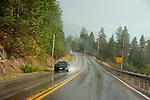 Driving in rainy wet weather on ruralroad near Flathead Lake, Montana
