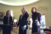 United States President George W. Bush meets with American aid workers Heather Mercer, left, and Dayna Curry in the Oval Office of the White House in Washington, D.C. on Monday, November 26, 2001..Mandatory Credit: Eric Draper - White House via CNP.
