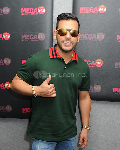 FORT LAUDERDALE, FL - MAY 12: Tito El Bambino visits Radio Station MEGA 94.9 on May 12, 2016 in Fort Lauderdale, Florida. Credit: mpi04/MediaPunch