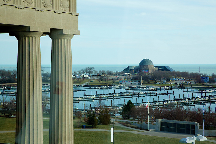 The old columns of historic Soldier Field, home of the Chicago Bears NFL football team, are seen in the foreground against a backdrop that includes the Adler Planetarium and Lake Michigan Thursday, Dec. 4, 2014. (DePaul University/Jeff Carrion)