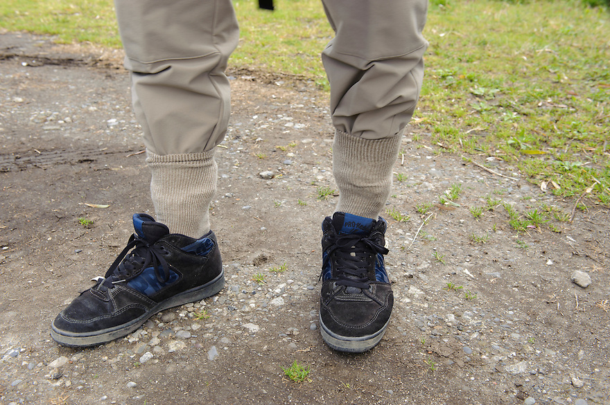 A visitor to Yamaguchi farm has tucked his socks into his trousers to protect against leeches, Otaki, Chiba prefecture, Japan, April 29, 2011.