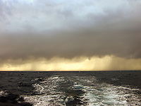 Rain storm behind boat