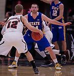 OMAHA, NE - South Dakota State's Zach Horstman #24 defends University of Nebraska at Omaha's Caleb Steffensmeier #12 during their game Thursday evening at Ralston Arena in Omaha, NE. (Photo By Ty Carlson/DakotaPress.org)