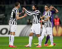 Calcio, ritorno degli ottavi di finale di Europa League: Fiorentina vs Juventus. Firenze, stadio Artemio Franchi, 20 marzo 2014. <br /> Juventus midfielder Andrea Pirlo, second from left, celebrates with teammates Leonardo Bonucci, left, and Martin Caceres as Fiorentina midfielder Alberto Aquilani, right, reacts at the end of the Europa League round of 16 second leg football match between Fiorentina and Juventus at Florence's Artemio Franchi stadium, 20 March 2014. Juventus won 1-0 to advance to the quarter-finals.<br /> UPDATE IMAGES PRESS/Isabella Bonotto