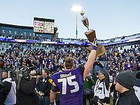 Jesse Sosebee hoists the Apple Cup trophy.
