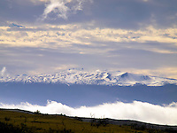 Snow-covered Mauna Kea, with the Kohala Mountain just north of it (in the foreground), Hawai'i Island.