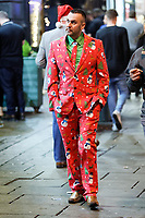 A man in festive suit Wind Street, Swansea, Wales  on Mad Friday, Booze Black Friday or Black Eye Friday, the last Friday night before Christmas Day, when traditionally people in the UK go out to celebrate the start of their holidays. Friday 22 December 2017