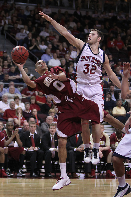 March 6, 2011; Las Vegas, NV, USA; Santa Clara Broncos guard Evan Roquemore (0) shoots the ball against Saint Mary's Gaels guard Mickey McConnell (32) during the WCC Basketball Championships at Orleans Arena.