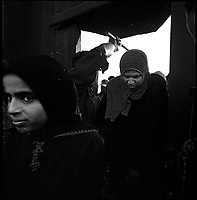 Rafah, Gaza strip, Sept 14 2005.Palestinians find gaps in the the 8 meter high wall  separating the Palestinian city from Egypt. Thousands  rushed across the border in an incredible chaos to visit relatives for the first time in 18 years and ... to bring back cheap Egyptian goods such as cigarets or gazoline.