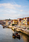 PORTUGAL, Porto, View of Riberia area and buildings, and boats along the river