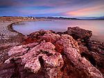 Sunrise illuminates odd rock formations found in the Gypsum Ledges near Bonelli Bay area in the Lake Mead National Recreation Area on the Arizona-Nevada border (Photo from Arizona looking into Nevada)