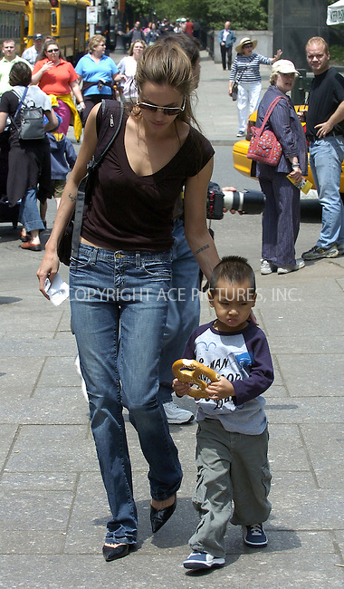 WWW.ACEPIXS.COM . . . . .  ....NEW YORK, JUNE 1, 2005....Angelina Jolie accompanied by her son Maddox (aka The Human Cannonball) take another carriage ride around Central Park. During the ride Maddox chews away at a pretzel until the two end up at Central Park's Carousel. Angelina Jolie laughs it up with Maddox while on the carousel. The two then head back to their carriage where Angelina continues to show what a dedicated and attentive mother she really is.....Please byline: Ian Wingfield - ACE PICTURES..... *** ***..Ace Pictures, Inc:  ..Craig Ashby (212) 243-8787..e-mail: picturedesk@acepixs.com..web: http://www.acepixs.com