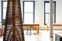 wooden artwork<br /> <br /> Jackie Ferrara is a well known sculptor and draughtswoman who took an old factory floor in Soho in 1971 and gradually transformed the space into a living and working loft making a lot of her own furniture, closets and shelves.