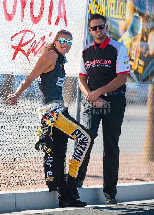 Oct 26, 2018; Las Vegas, NV, USA; NHRA top fuel driver Leah Pritchett (left) with husband Gary Pritchett during qualifying for the Toyota Nationals at The Strip at Las Vegas Motor Speedway. Mandatory Credit: Mark J. Rebilas-USA TODAY Sports