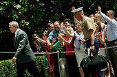 United States President George W. Bush walks to the residence after greeting visitors to the White House following his and first lady Laura Bush's arrival via Marine One on the south lawn of the White House in Washington, DC after a weekend spent relaxing at Camp David in Maryland on June 19, 2005.<br /> Credit: Jay L. Clendenin / Pool via CNP