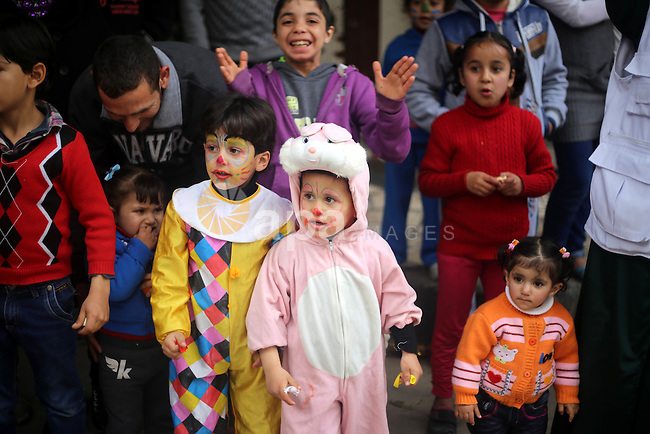 Palestinian children attend  a street game organised by volunteers of the Friday of Joy Initiative, in al-Shati refugee camp, in Gaza city, February 6, 2015. Ten Palestinian volunteers organise street games, painting and drama, every Friday afternoon in the streets of  refugee camps and provide outlets for the children's energy with organised games, dancing and singing, which gives extra psycho-social support to vulnerable children. Photo by Khaled al-Sabbah