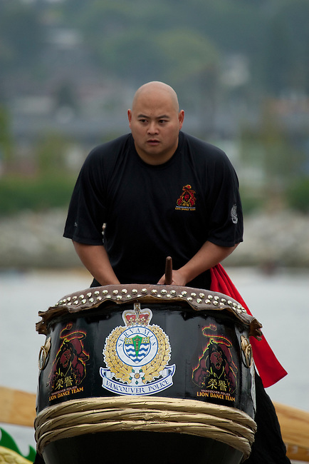 """Vancouver, Canada, Aug 8th 2009. World Police and Fire Games, Dragon Boat Competition.  Vancouver Police Department Lion Dance Team's drummer opens the Dragon Boat competition at the """"Awaken the Dragon"""" ceremony.  Photo by Gus Curtis"""