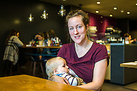 A mother breastfeeding her 10 month old son in a restaurant.<br /> <br /> Herefordshire, England, UK<br /> 09/01/2015<br /> <br /> &copy; Paul Carter / wdiip.co.uk