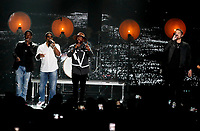 NASHVILLE, TN - JUNE 5: Shawn Stockman, Nathan Morris and Wanya Morris of Boyz II Men and Brett Young (R) perform on the 2019 CMT Music Awards at Bridgestone Arena on June 5, 2019 in Nashville, Tennessee. (Photo by Frederick Breedon/PictureGroup)