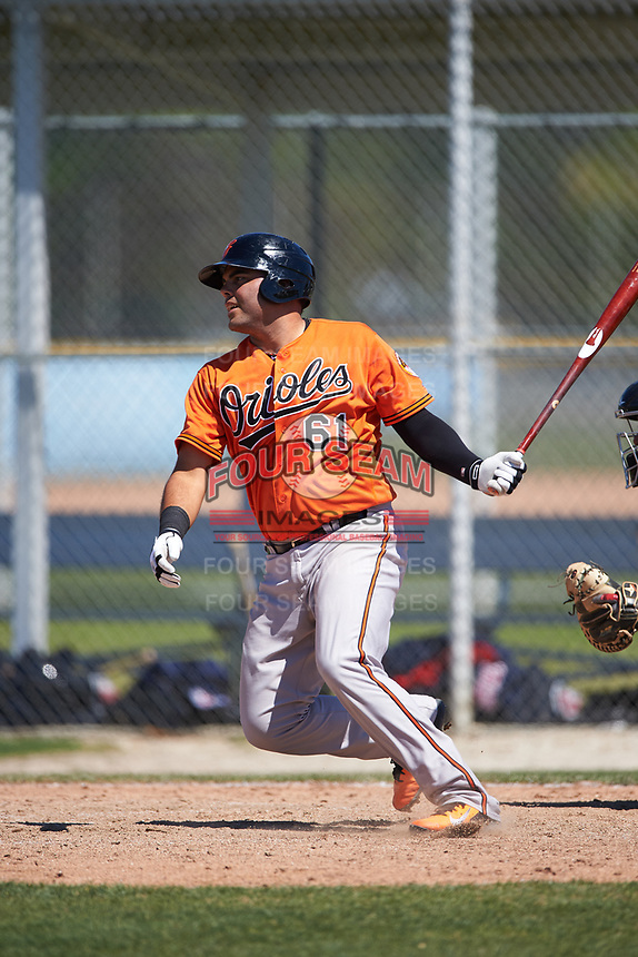 Baltimore Orioles catcher Ronald Soto (61) follows through on a swing during a minor league Spring Training game against the Minnesota Twins on March 17, 2017 at the Buck O'Neil Baseball Complex in Sarasota, Florida.  (Mike Janes/Four Seam Images)