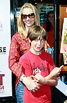 US actress Lisa Kudrow arrives with her son Julian at the world premiere of 'Kit Kittredge: An American Girl' at the Grove in Los Angeles, California on 14 June 2008. The film is based on the American Girl doll line and centers on Kit Kittredge, a young woman who grows up in the early years of the Great Depression.