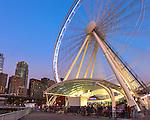 Seattle, Washington<br /> Seattle Great Wheel, a Ferris wheel on the Elliott Bay waterfront at dusk