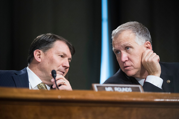 UNITED STATES - FEBRUARY 01: Sens. Dan Sullivan, R-Alaska, right, and Mike Rounds, R-S.D., attend the Senate Veterans' Affairs Committee confirmation hearing in Dirksen Building for David Shulkin, nominee for Veterans Affairs secretary, February 1, 2017. (Photo By Tom Williams/CQ Roll Call)
