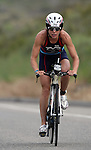 OCEANSIDE, CA- APRIL 2:  rides her bike through Camp Pendleton during Rohto Ironman 70.3 California in Oceanside, California on April 2, 2011. (Photo by Donald Miralle for LAVA Magazine) *** Local Caption ***