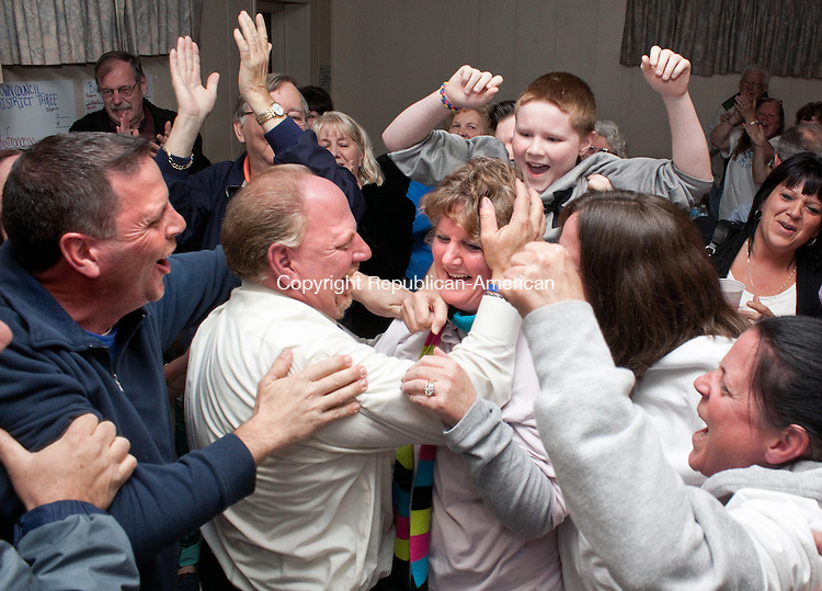 WOLCOTT CT-NOVEMBER 05 2013 110513DA08- Re-elected Wolcott Mayor Thomas G. Dunn hugs his sister Darlene Tynan surrounded by family and friends as the final poles came in electing Tynan as Wolcott Tax Collector. The event was held at the Wolcott VFW Tuesday night.<br /> Darlene Douty Republican American