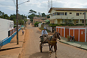 Pará State, Brazil. Tucumã. Horse and cart on a street.