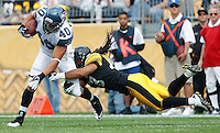 PITTSBURGH - SEPTEMBER 18:  Troy Polamalu #43 of the Pittsburgh Steelers attempts to tackle Eddie Williams #40 of the Seattle Seahawks during the game on September 18, 2011 at Heinz Field in Pittsburgh, Pennsylvania.  (Photo by Jared Wickerham/Getty Images)