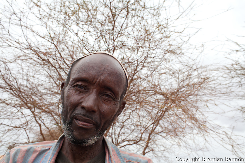 "Mohamed Yare traveled with the 25 members of his extended family after selling his house and all of his belongings in Dinsor, Somalia. Two years ago the house would have brought $3,000 dollars. Last month he sold it for $150.00 and considered himself lucky. Everybody ants to sell their land and there are few people left in Dinsor. Only the very wealthy and the very poor and the poor disabled ones are dying. In the countryside there is nobody. Every person and thing is dying."" said Mohamed. He arrived on July 28th. ""we don't have where to sleep yet and nothing to build a house with today. people are sleeping some 16 to a house. We might have to sleep right here on the ground here,"" He said."