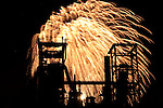 Fireworks in the Westfalenpark, Dortmund, Germany, behind the silhouette of the ancient smeltery Phoenix in Dortmund-Hoerde. / Feuerwerk im Westfalenpark, Dortmund, hinter der Silhouette des ehemaligen Hüttenwerkes Phoenix in Dortmund-Hörde.