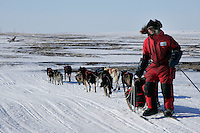Tuesday March 13, 2007   ----   Lance Mackey runs along the beach driftwood 30 miles outside of Nome.
