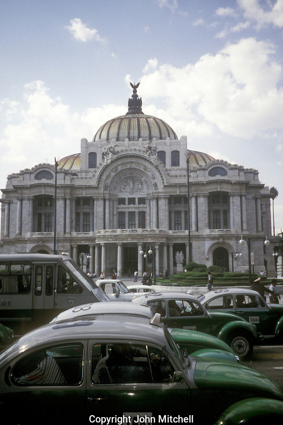 Green and white Volkswagen Bug (VW Beetle) taxis in front of the Palacio de Bellas Artes in Mexico City, Mexico