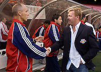 Chivas head coach Bob Bradley shakes hands with Red Bulls head coach Mo Johnston before the game. The NY Red Bulls defeated CD Chivas USA 5-4 at Giants Stadium, East Rutherford, NJ, on May 20, 2006.