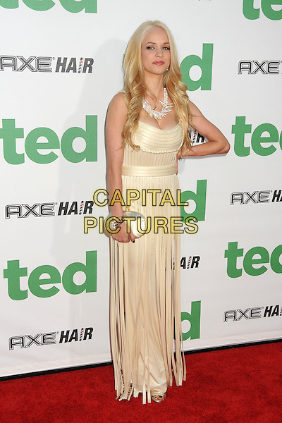Alexis Knapp.The L.A. Premiere of 'Ted' held at The Grauman's Chinese Theatre in Hollywood, California, USA..June 21st, 2012.full length white cream gold dress straps tassels fringed silver clutch bag hand on hip.CAP/ADM/BP.©Byron Purvis/AdMedia/Capital Pictures.