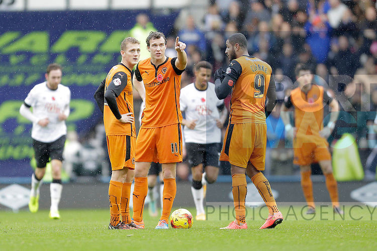 George Saville, Kevin McDonald and Leon Clarke look at the big gscreen to see where they went wrong following Derby's second goal - Football - Sky Bet Championship - Derby County vs Wolverhampton Wanderers - iPro Stadium Derby - Season 2014/15 - 8th November 2014 - Photo Malcolm Couzens/Sportimage