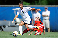26 September 2010:  FIU's Kim Lopez (7) passes the ball while avoiding ASU's Anna Kaloghirou (8) in the second half as the FIU Golden Panthers defeated the Arkansas State Red Wolves, 1-0 in double overtime, at University Park Stadium in Miami, Florida.